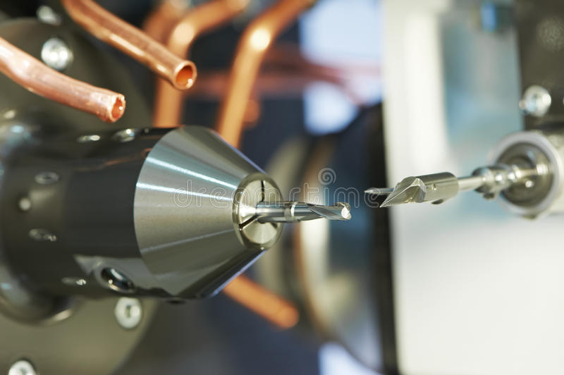 Tool measurement machine. Rapid machining steel drill for metalwork at machine tool measurement royalty free stock photos