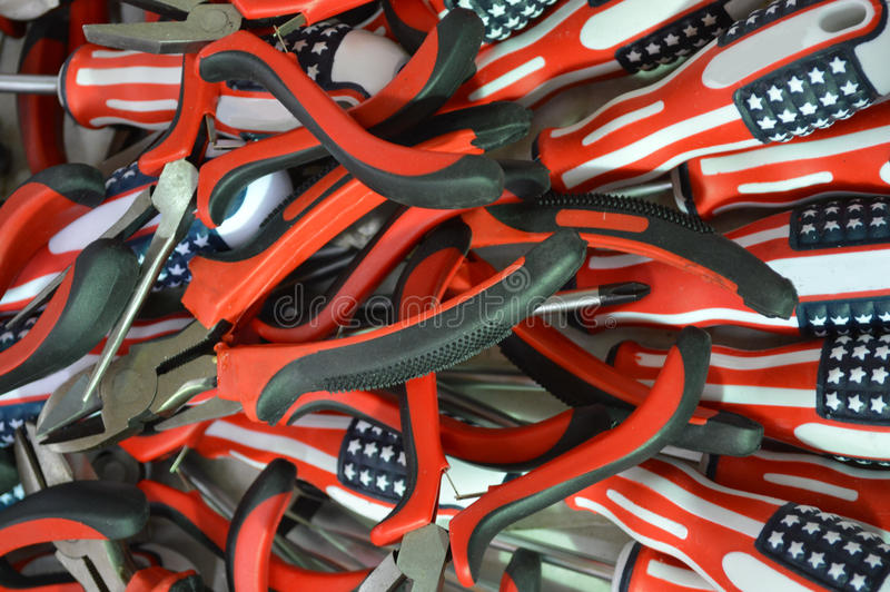 Tool. The photo shows a pile of Electricity pliers and screwdrivers of different sizes exhibited for sale at bargain prices. Paneling tools made of plastic of royalty free stock photos