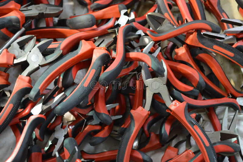 Tool. The photo shows a pile of Electricity pliers and Side-cutters of different sizes exhibited for sale at bargain prices. Paneling tools made of plastic of stock photography