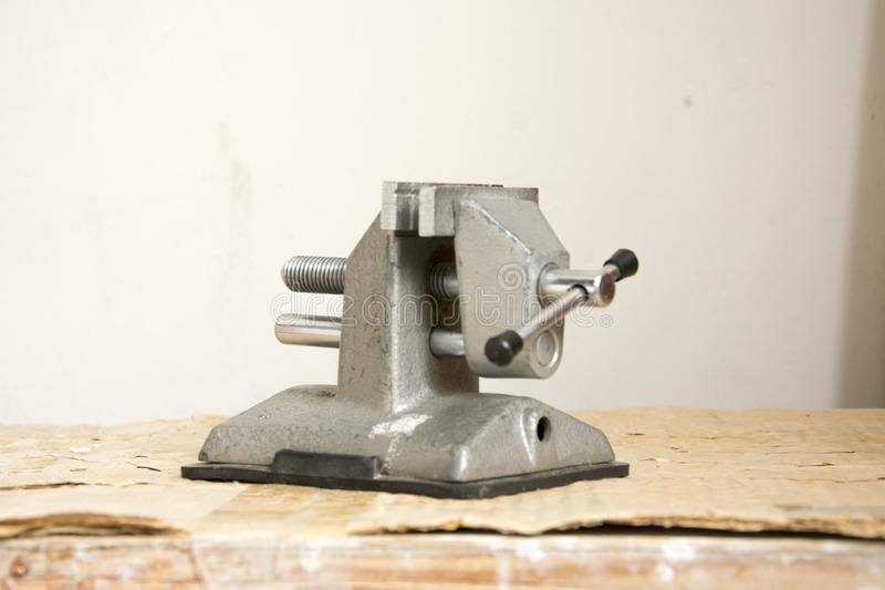Tool for repair, small portable vice gray steel with vacuum fast. Ening stock photography