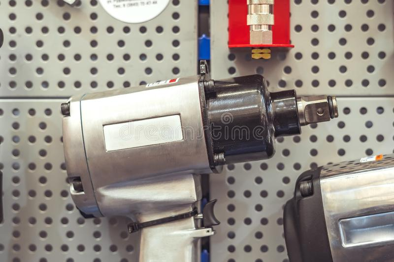 Tool on the stand. Electric tools for construction on the stand in the shop royalty free stock image