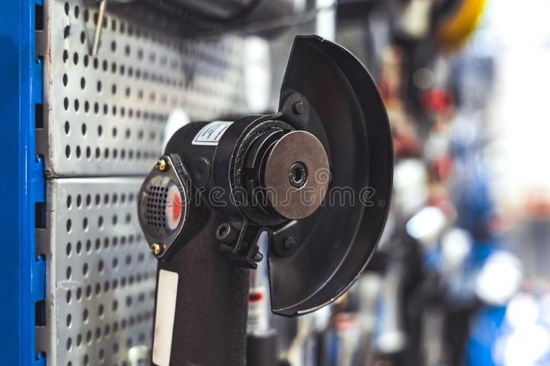 Tool on the stand. Electric tools for construction on the stand in the shop stock image