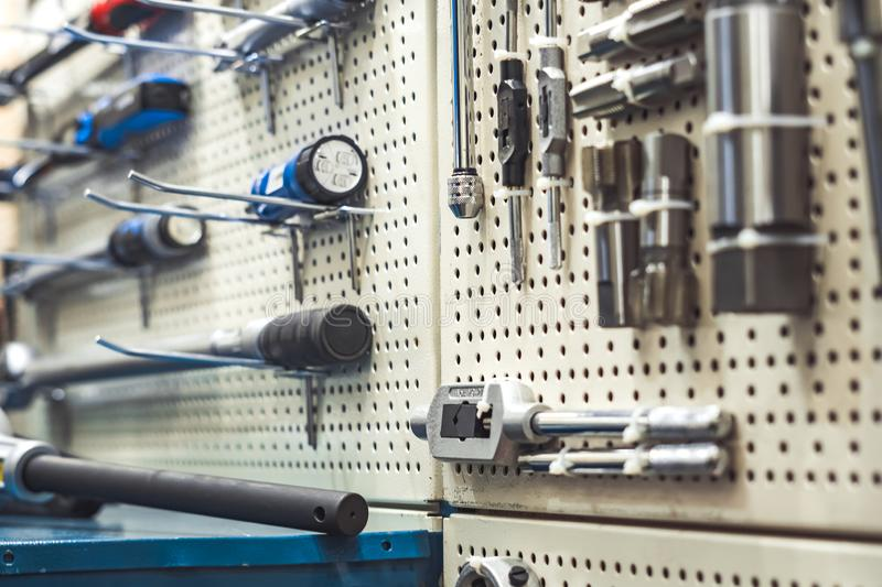 Tool on the stand. Electric tools for construction on the stand in the shop royalty free stock photo