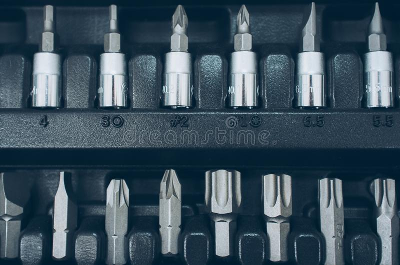 Toolbox socket organizer screwdriver bit set. Toolbox socket organizer. Closeup of screwdriver bit set. Professional chrome instruments royalty free stock images