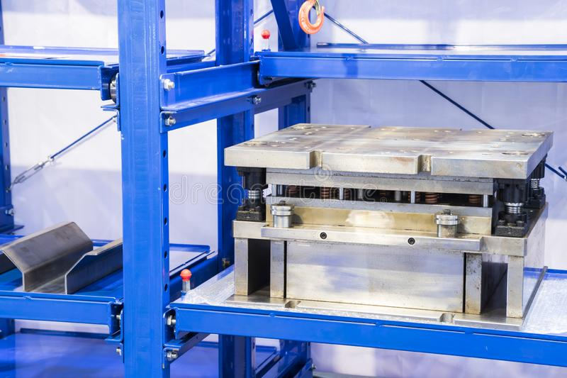 Tooling or die for metal processing keeping in shelf. Close up, steel, mold, stamping, industrial, pattern, business, white, shape, plastic, product stock photo
