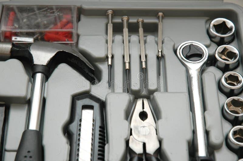 Toolkit van diverse hulpmiddelen stock afbeeldingen