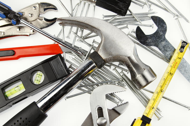 Tools. Assorted work tools on plain background royalty free stock photos