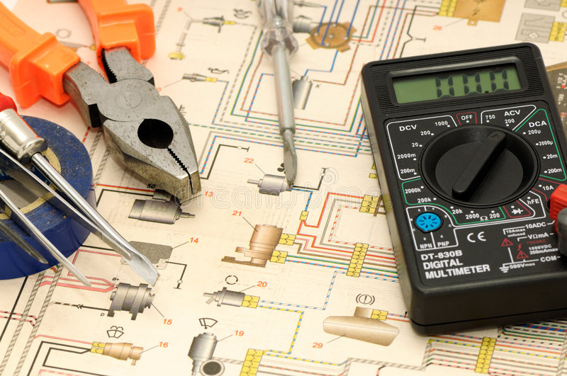 Tools. On a background of the electric scheme stock images