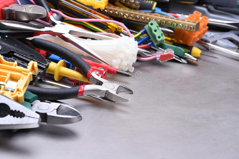 Tools and accessories used in electrical installations stock images