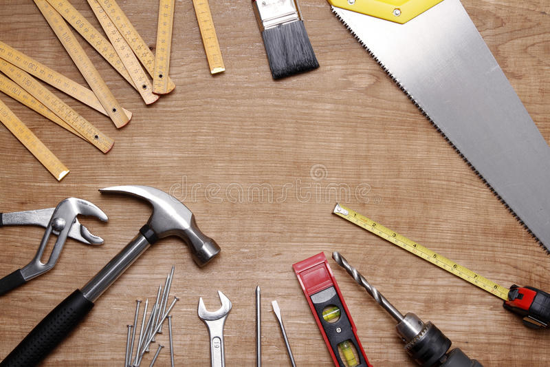 Tools. Assorted work tools on wood stock image