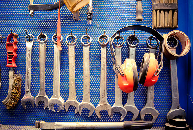 Tools in auto repairs shop. Real work environment. Tools in auto repairs shop, the tyre workshop part: ratchet combination wrenches in many sizes, and other stock images