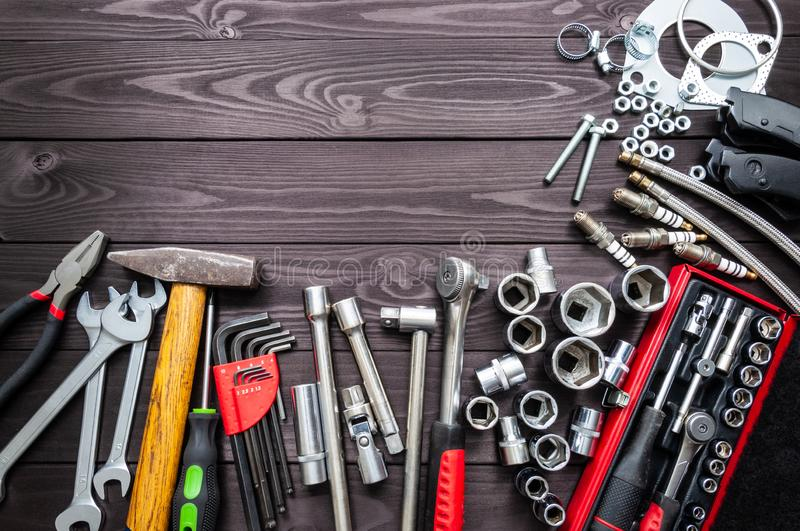 Tools and auto spare parts on wooden workbench. copy space stock images