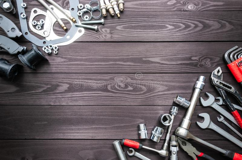 Tools and auto spare parts on wooden workbench. copy space stock photography
