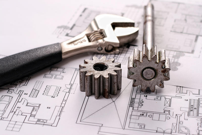 Tools on Blueprints including sprocked stacks and. Monkey wrench. House plans printed on white paper royalty free stock photo