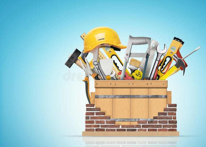 Tools. Box with construction tools and brick wall stock photography