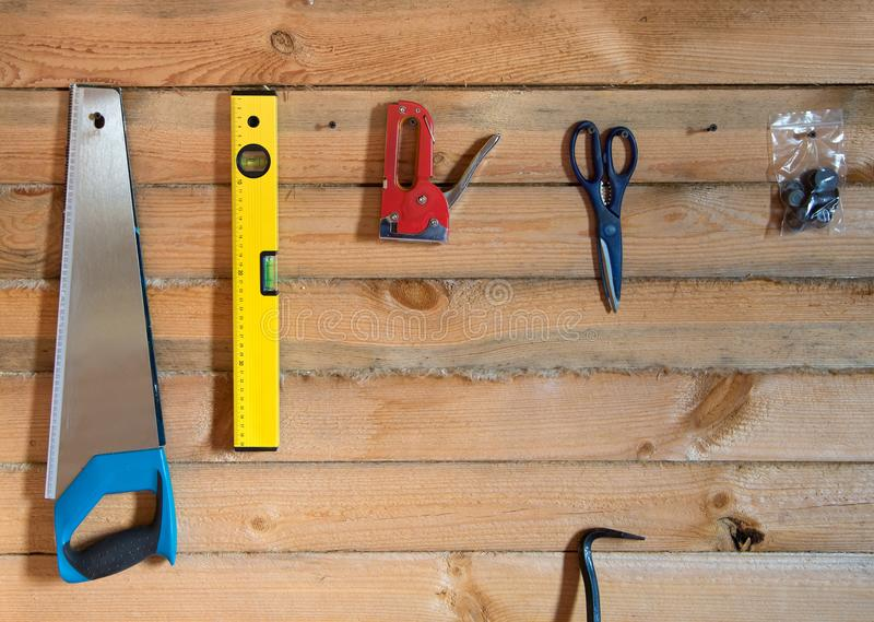 Tools for building on wooden background of pine forest royalty free stock photography