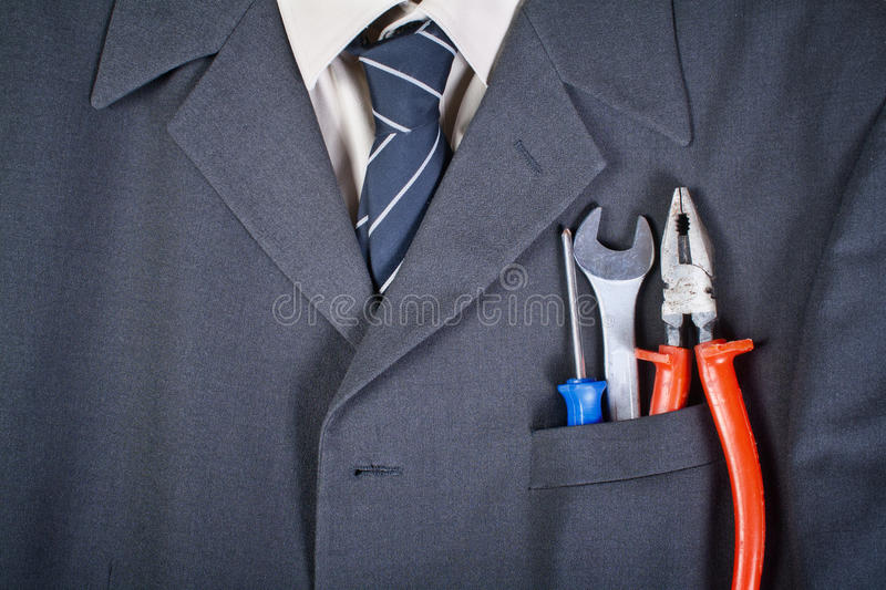 Tools in the businessman pocket stock photo