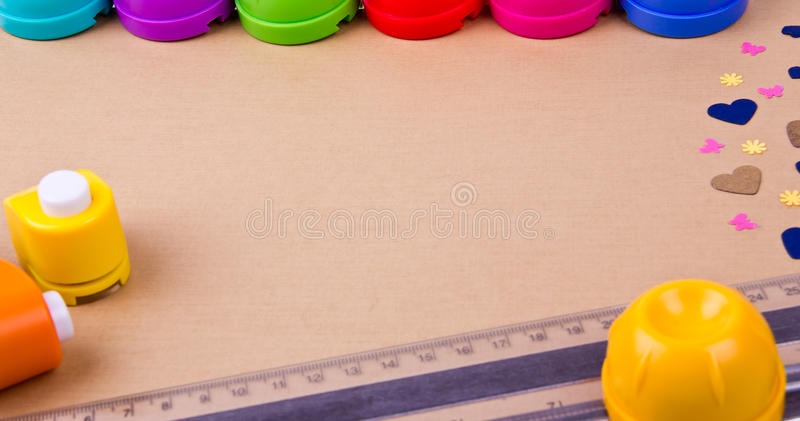 Tools for card making and scrap booking. On a paper stock image