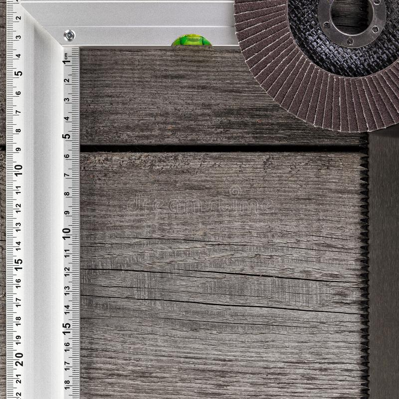 Tools for carpentry work, measurement of parts and eye protection on a wooden background.  royalty free stock images