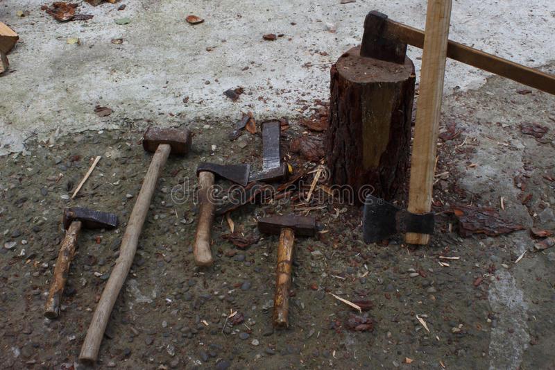 Tools for chopping trees. old rusty axe, wedges and sledgehammer royalty free stock images