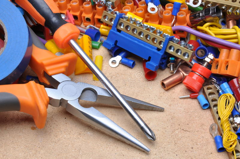 Tools and component for electrical installation. Colorful tools and component for electrical installation royalty free stock photos