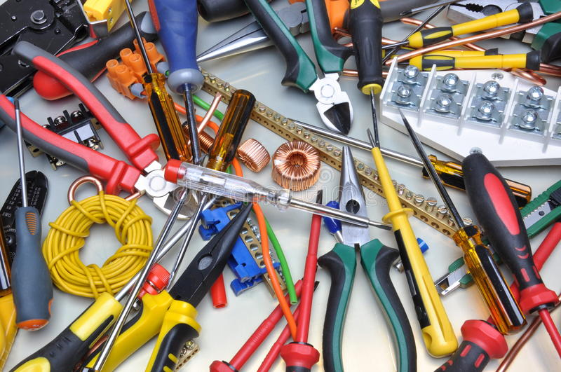 Tools and component kit to use in electrical installations. Set of tools and component kit to use in electrical installations royalty free stock images