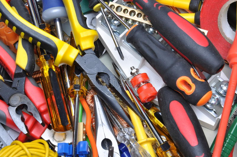 Tools and component kit to use in electrical installations. Set of tools and component kit to use in electrical installations royalty free stock photo