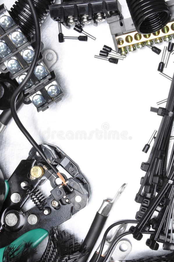 Tools and component kit for use in electrical installations. On metal background stock image