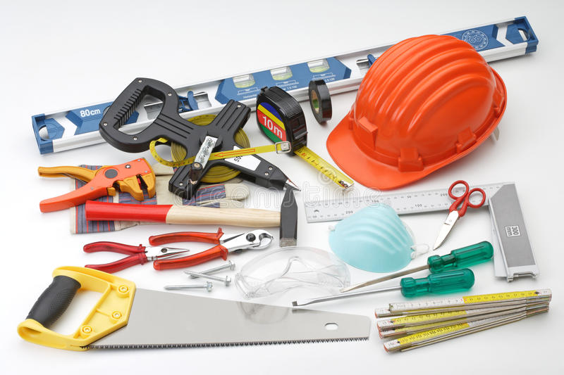 Helmet and tools for constructions. Tools about constructions work and bricolage stock photos