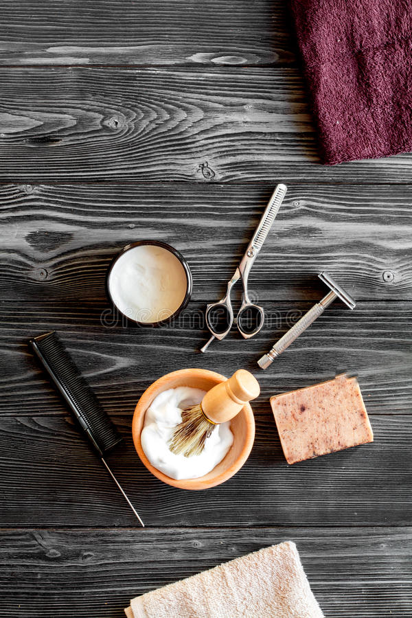 Tools for cutting beard barbershop top view on wooden background. Tools for cutting beard barbershop top view on dark wooden background royalty free stock photo