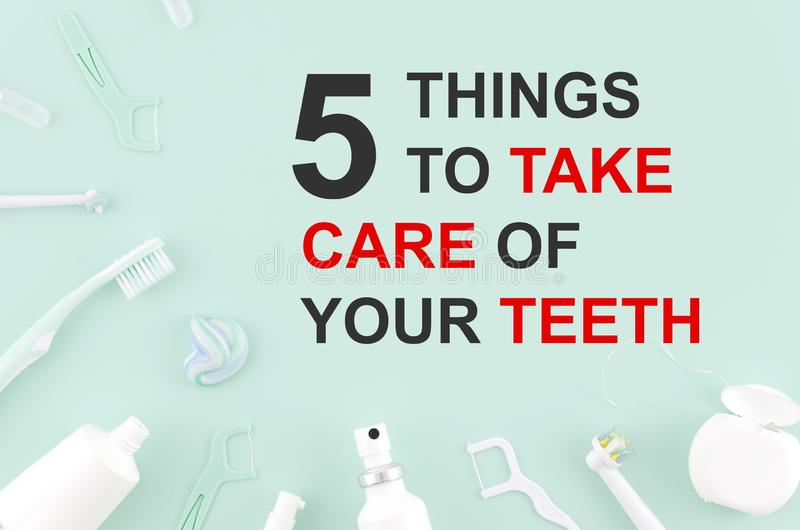 Tools for dental care: orthodontic brush, floss, toothpaste. Flat lay top view 5 things to take care of your teeth stock image