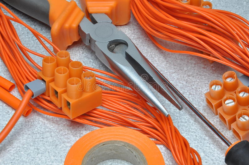 Tools and electrical component kit. To use in electrical installations stock photos