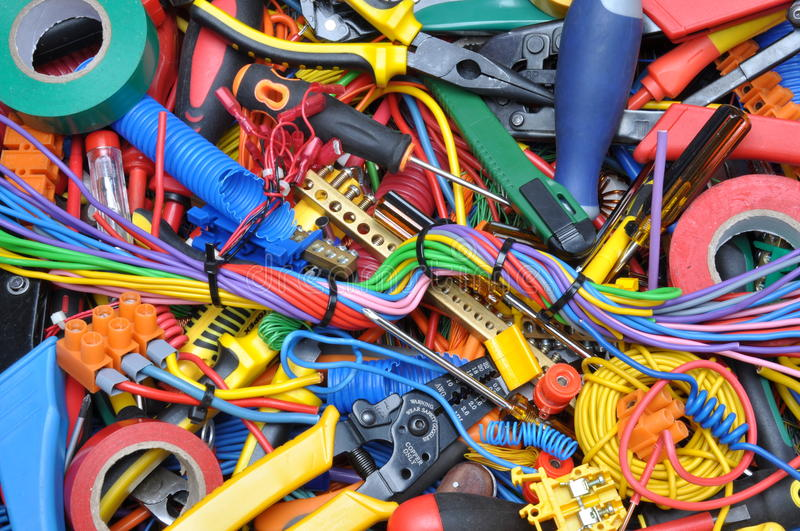 Tools and electrical component kit used in electrical installations. St of tools and electrical component kit used in electrical installations stock image