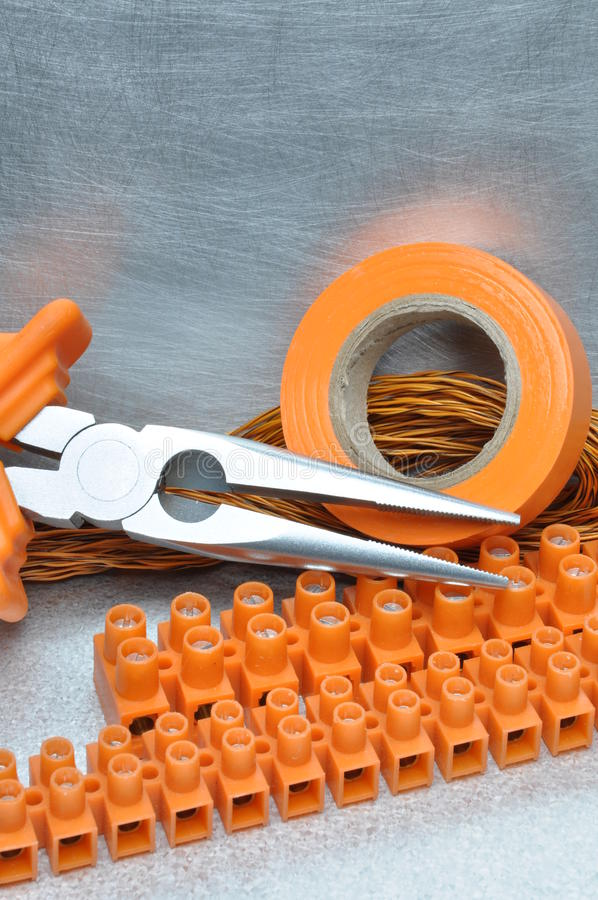 Tools and electrical component on metal surface. With place for text stock photo