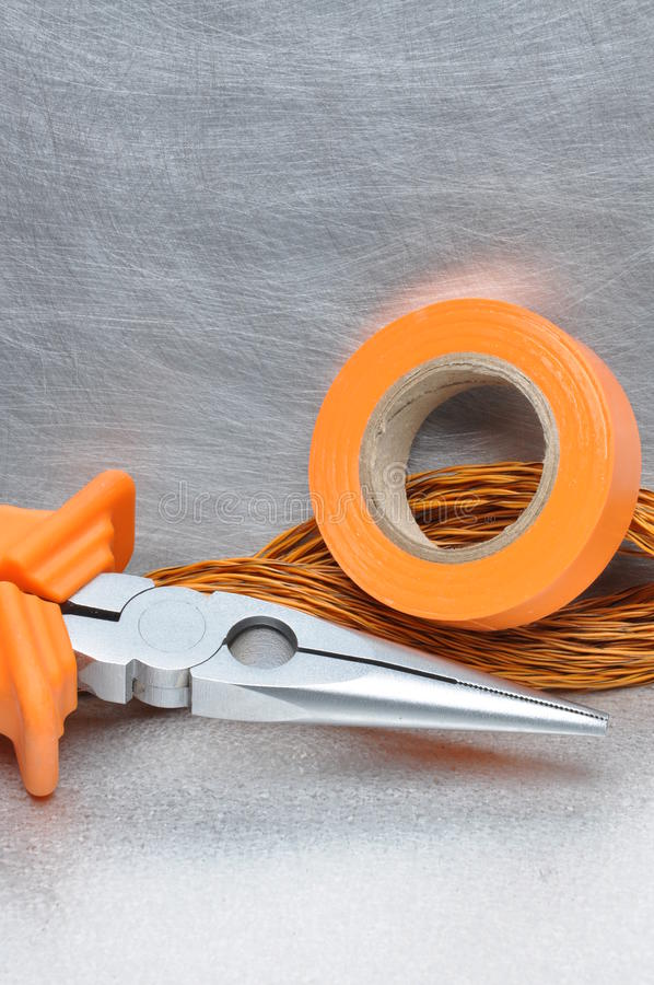 Tools and electrical component on metal surface. With place for text stock photography