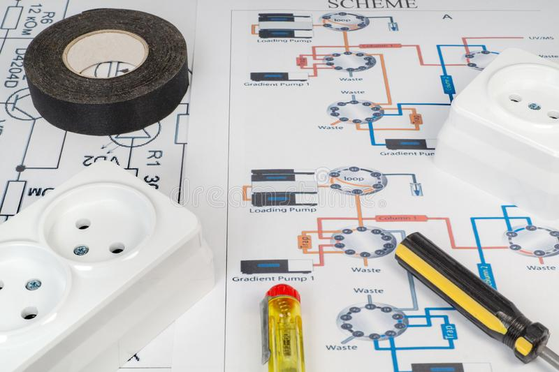Tools for electricians and sockets on the grey surface stock image
