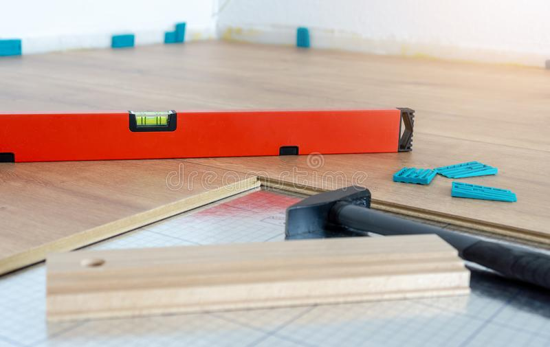 Tools and equipment for laying of laminate floor, spirit level, folding ruler, pulling iron royalty free stock images