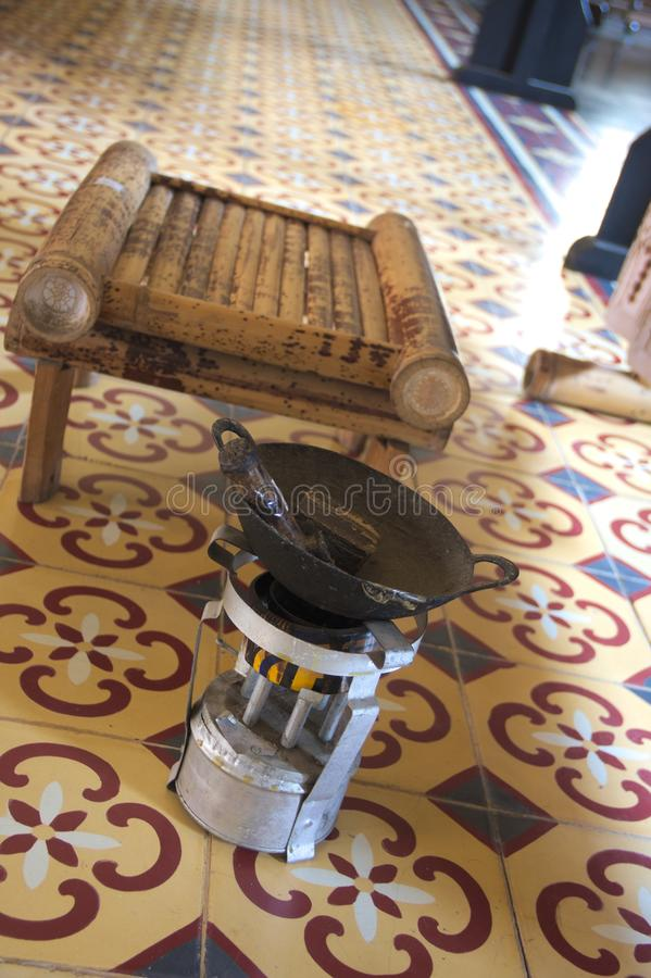 Tools and equipment for making batik. Bamboo chair, mini stove, mini frying pan and canting, tools that using for batik process in Indonesia stock photo