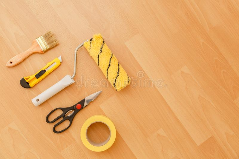 Tools for gluing wallpapers. Renovation. Tools for gluing wallpapers. A room after renovation. Fresh repair in a room. Floor from laminate royalty free stock images