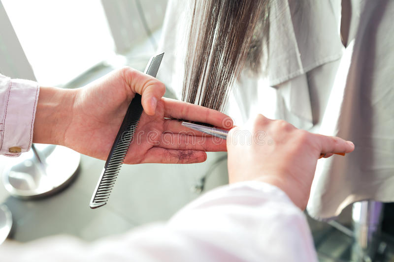 Tools hairdresser. A girl with long black hair stock photos
