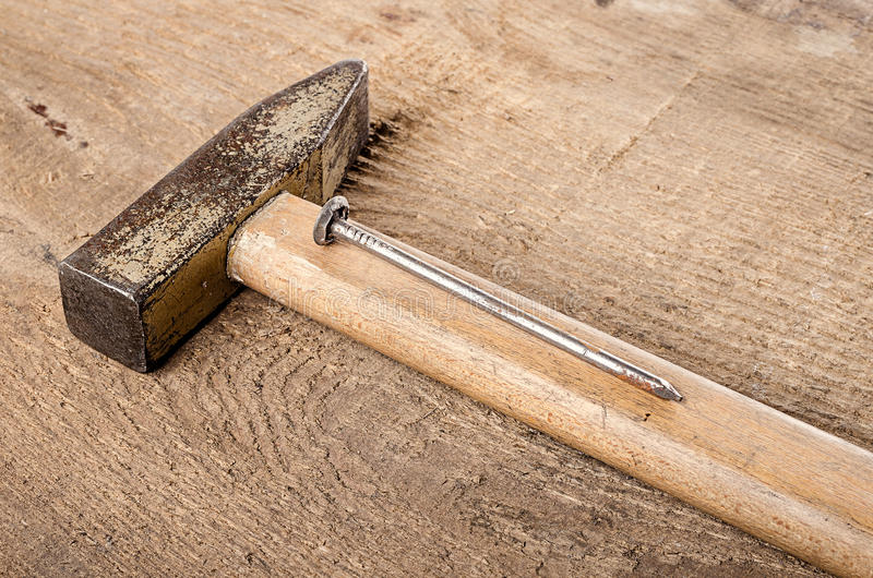 Tools. A hammer and nails on wooden background. Ready for work. Tools. Ready for work. A hammer and nails on wooden background royalty free stock images