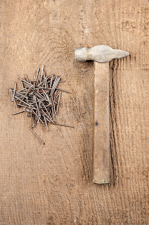 Tools. A hammer and nails on wooden background. Ready for work. Tools. Ready for work. A hammer and nails on wooden background stock image