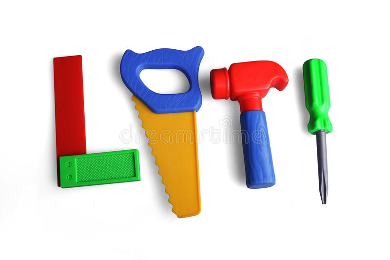 Tools, hammer, saw, screwdriver, angle, plastic. Toys on a white background royalty free stock photos