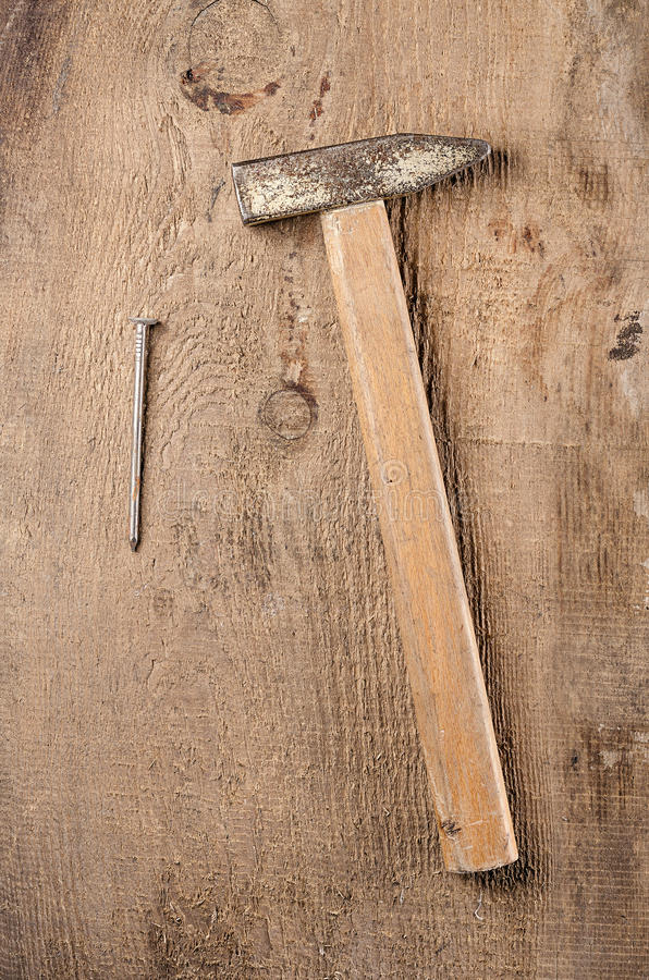 Tools. A hammer on wooden background. Ready for work. Tools. Ready for work. A hammer on wooden background royalty free stock photography