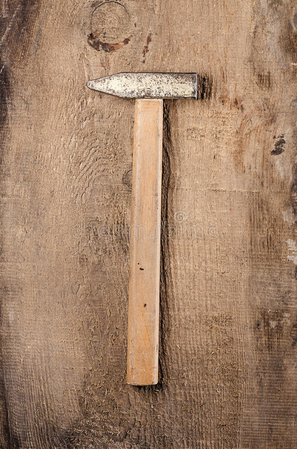 Tools. A hammer on wooden background. Ready for work. Tools. Ready for work. A hammer on wooden background stock images