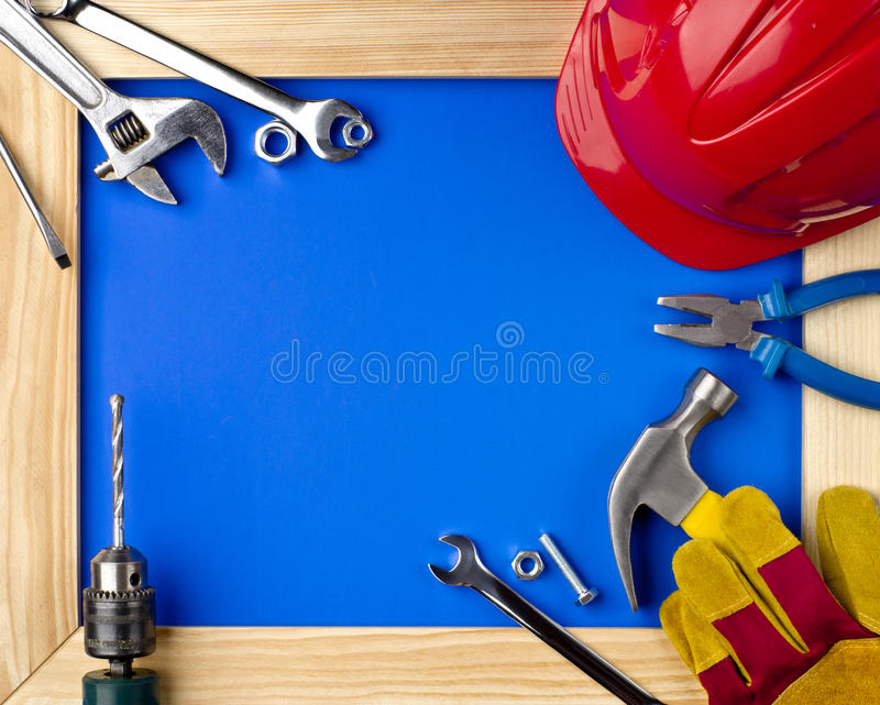 Tools and helmet in a wooden frame stock photo