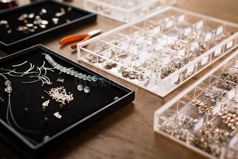 Tools for jewelry making, colorful stone beads. Jewellry workplace. royalty free stock image
