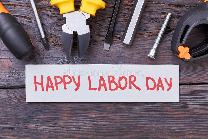 Tools and Labor Day card. stock photography