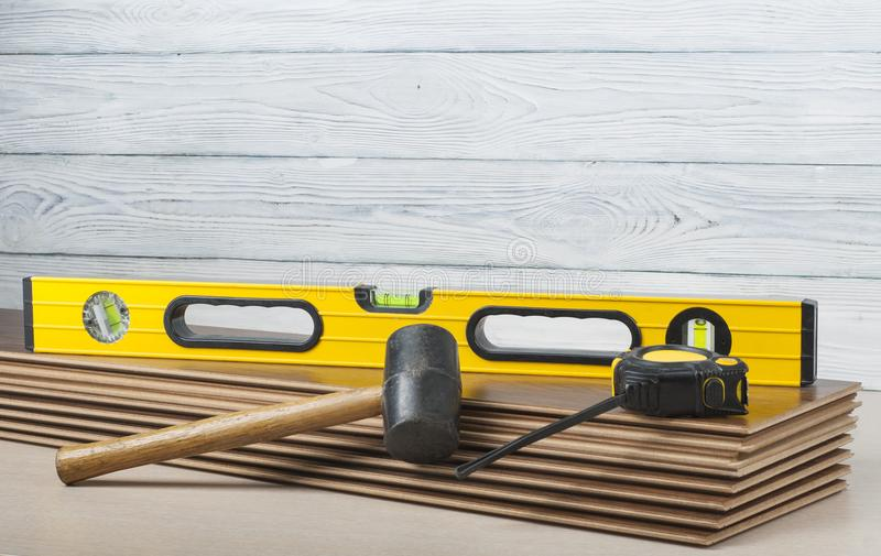Carpentry concept. Different tools on the new laminate flooring.Copy space for text. royalty free stock photo