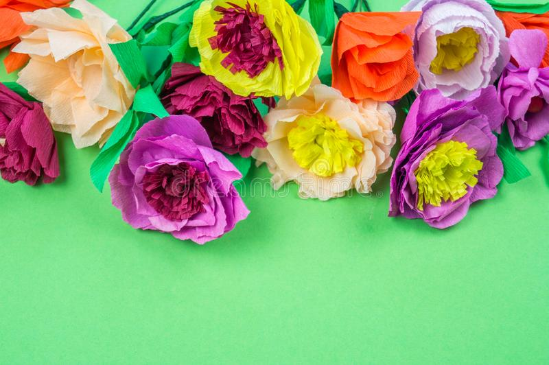 Tools making crepe paper flowers green background. Utensils and tools for making crepe paper flowers on green background. Cosmos flower bouquet stock photography